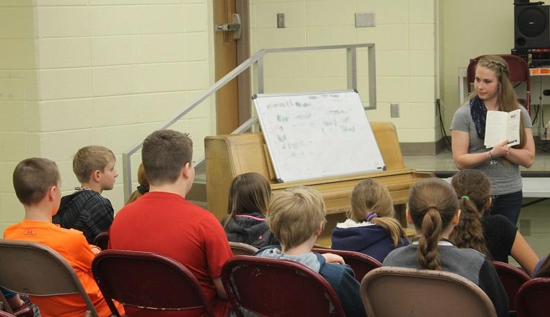 High school author encourages children