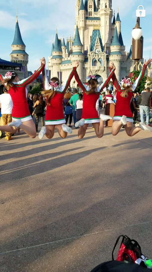 Cheerleaders perform in the Magic Kingdom