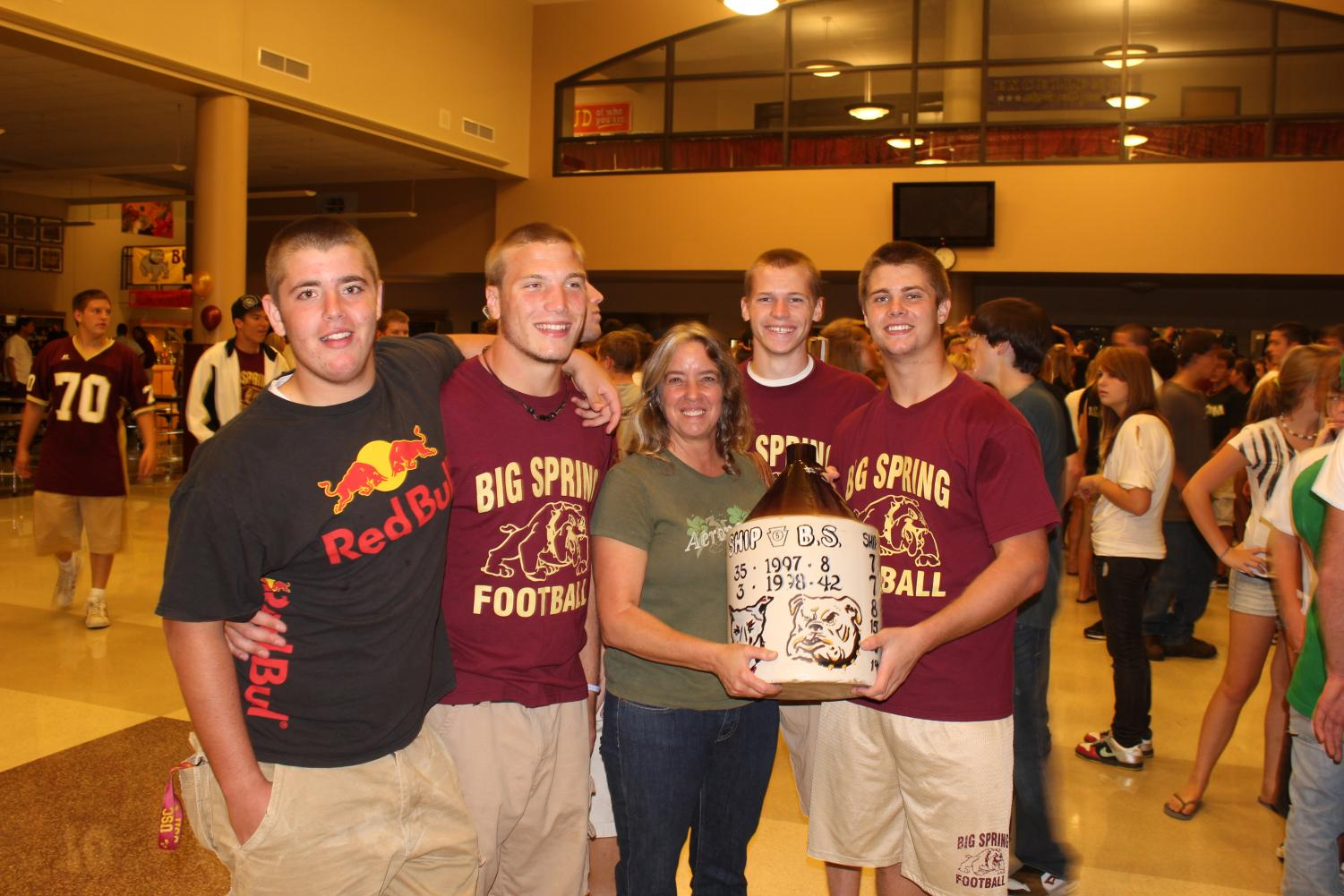 Members of the 2010 football team celebrate with the Little Brown Jug after their big win over Shippensburg. This years game is to be held on November 3, 2017 at Shippensburg.