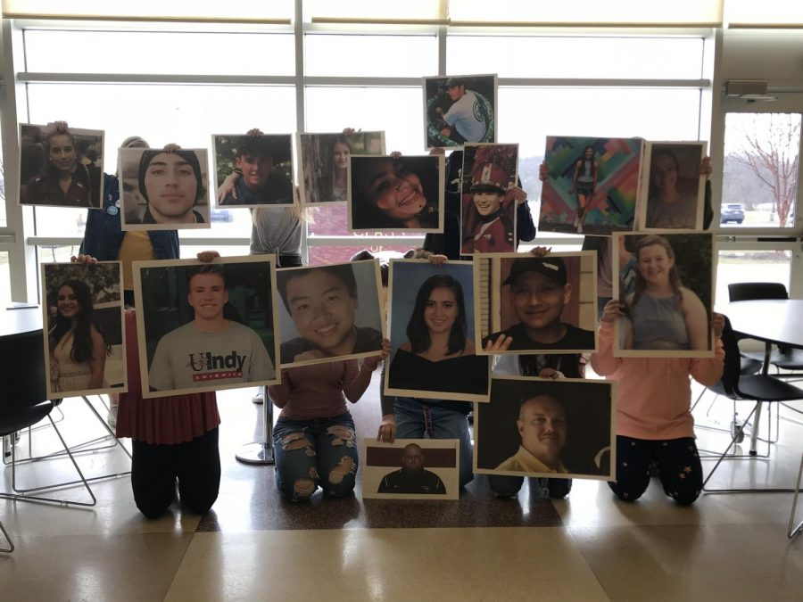 The student leaders who organized the walkouts pose for a picture with the victims of Parkland. The walkout was held March 14th at 10 to memorialize the deaths of the students and staff.