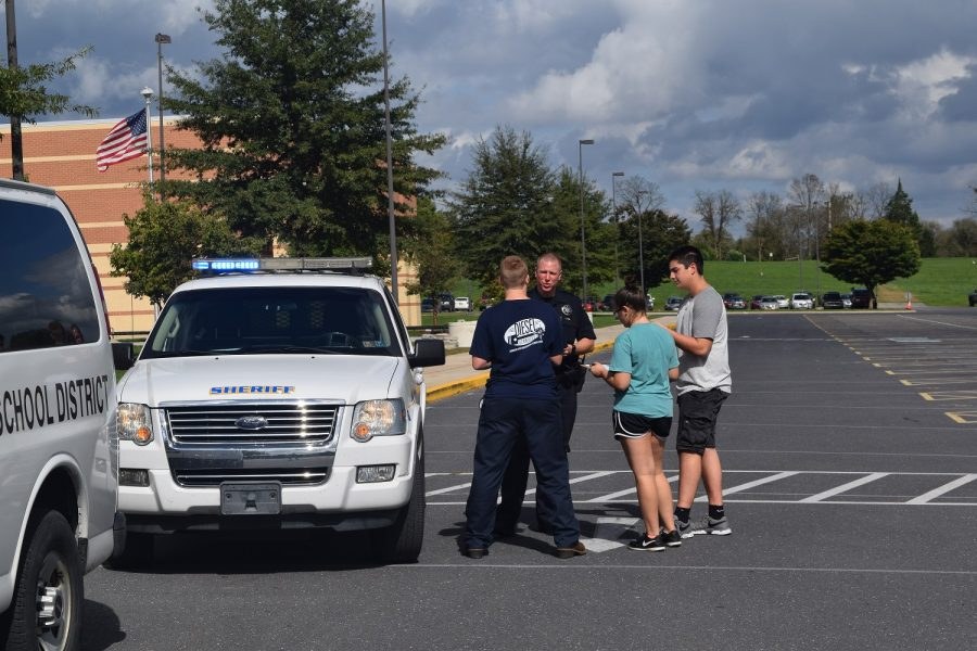 Deputy Brian Gryzboski demonstrates how an officer would approach a vehicle in the event of a traffic stop. Students in each Driver's Ed class for the past 2 years have had the opportunity to participate in a mock traffic stop lesson.