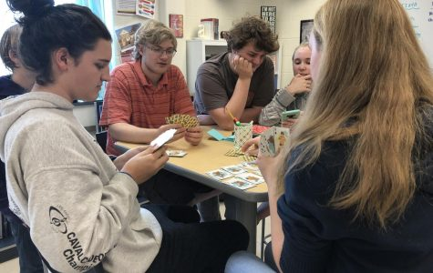 A friend group of sophomores gather to play war during their free period. Playing cards during their free period is a was for students to calm down and enjoy the simple things in life.