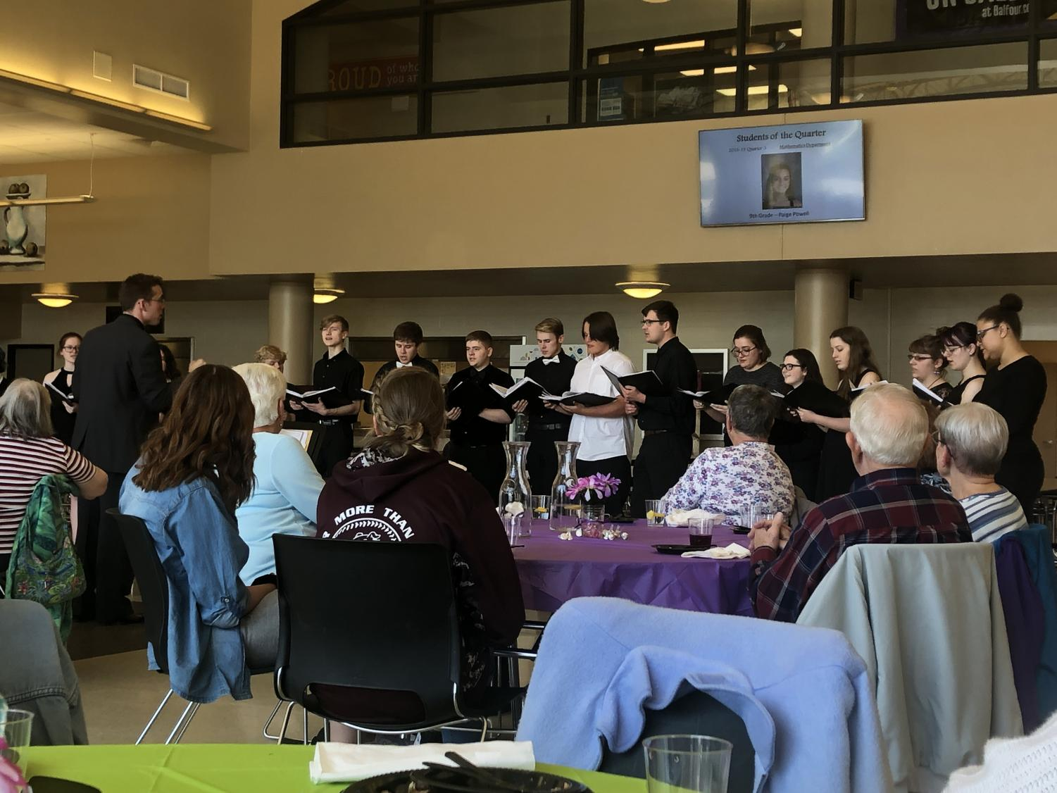 Cantabile sings for the seniors as they finish their desert with some beautiful music.