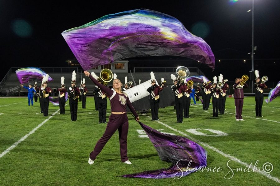 Briana+Reidel+%2812%29%2C+performing+with+swing+flags+in+the+ballad+as+the+band+plays+the+impact+moment+of+the+movement.+The+band+has+3+more+competitions+before+championships.+