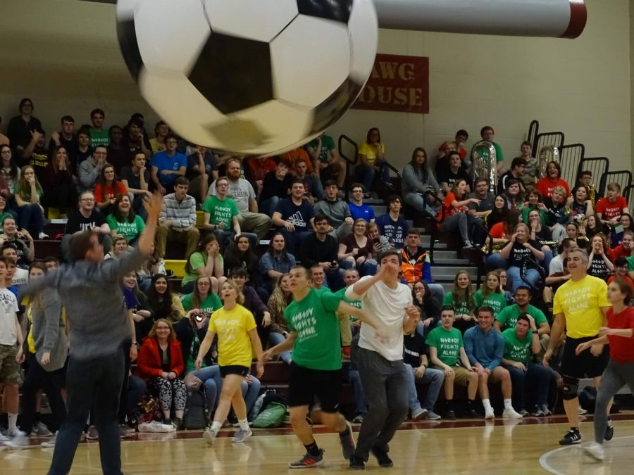 Teachers+and+students+are+playing+inflatable+soccer+during+the+Mini-+Thon+pep+rally.+They+prepare+for+the+big+reveal+to+see+how+much+money+they+have+raised+for+the+kids.+