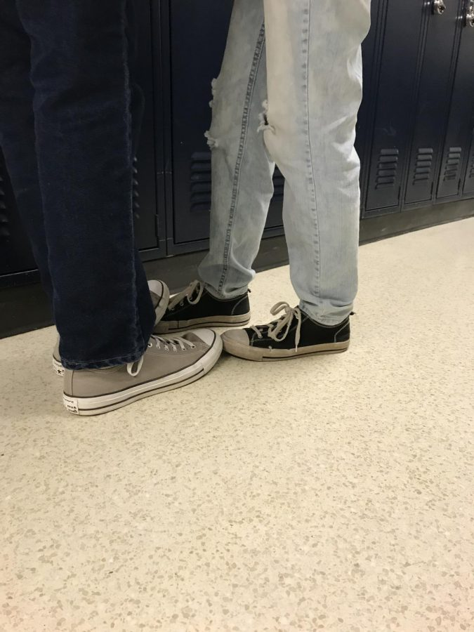 Students stand close together by the lockers before class. PDA is an issue at the high school.
