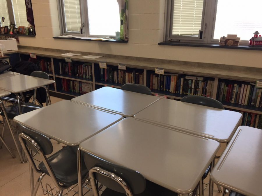 The old desk and hard-back chairs will be replaced next year with more comfortable options. Several classrooms will be making the transition.