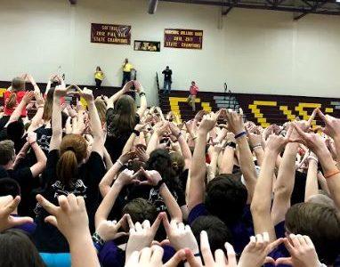 Students of Mini-Thon holding peace. Mini-Thon was a blast