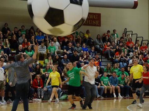Teachers and students are playing inflatable soccer during the Mini- Thon pep rally. They prepare for the big reveal to see how much money they have raised for the kids.